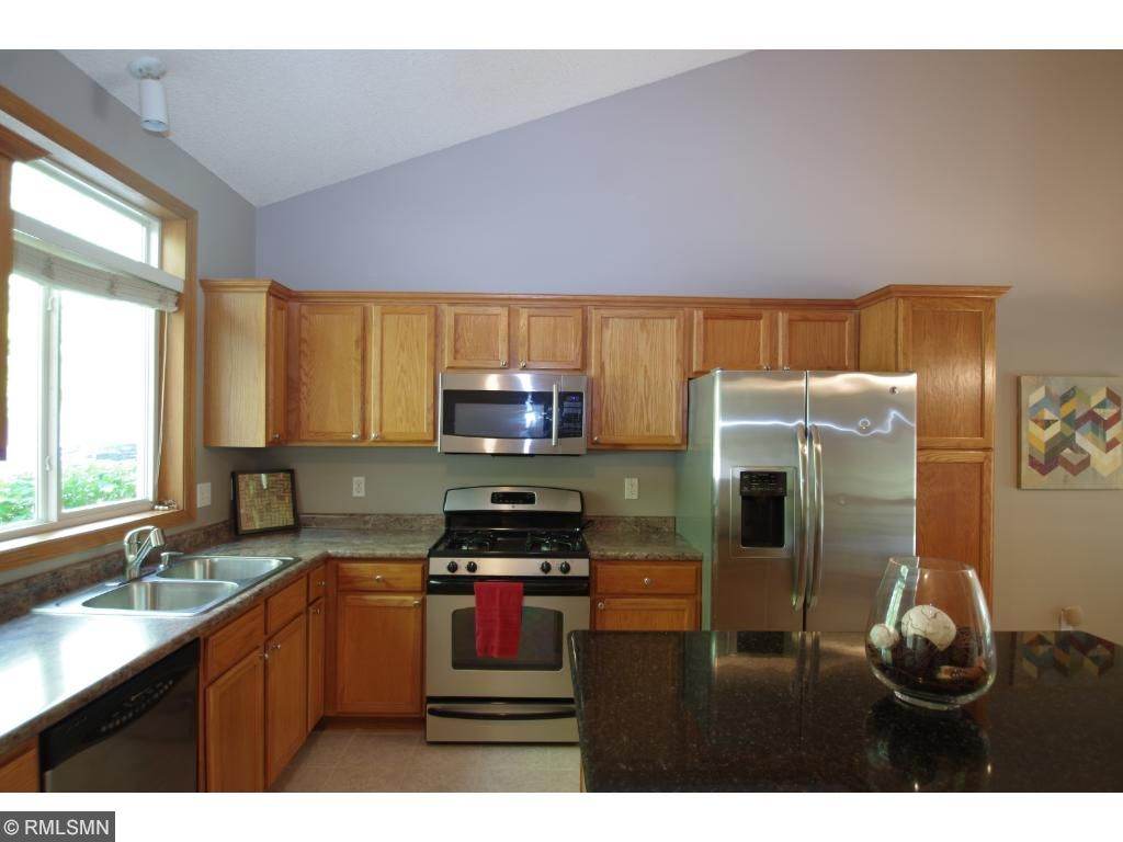 Big Granite Island.New floors.  Stainless Appliances.  You'll love the brand new, modern Kitchen!