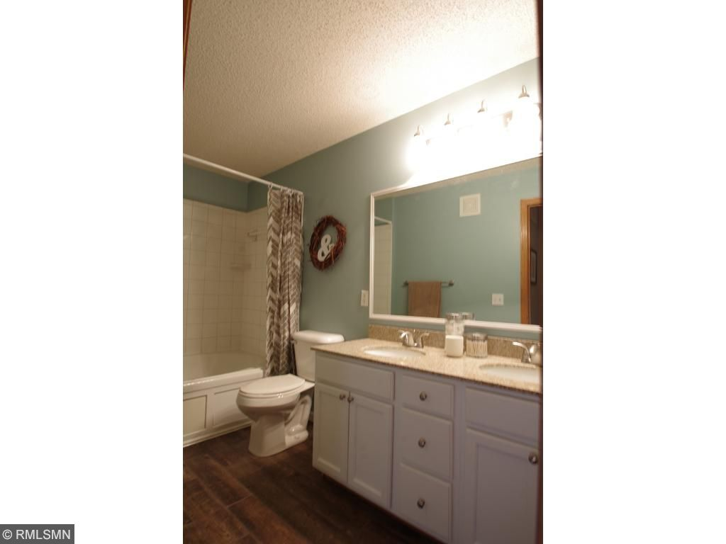 You'll love this wood look tile! Granite double sinks.  Jacuzzi tub.