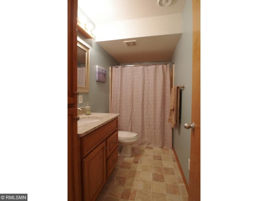 Beautiful stone tile!  New Main level bath.  Granite sink and new faucet.