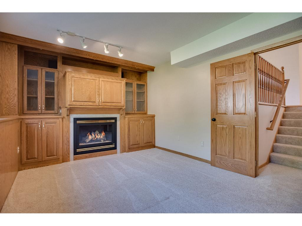 Gas fireplace and built-in cabinet surround!