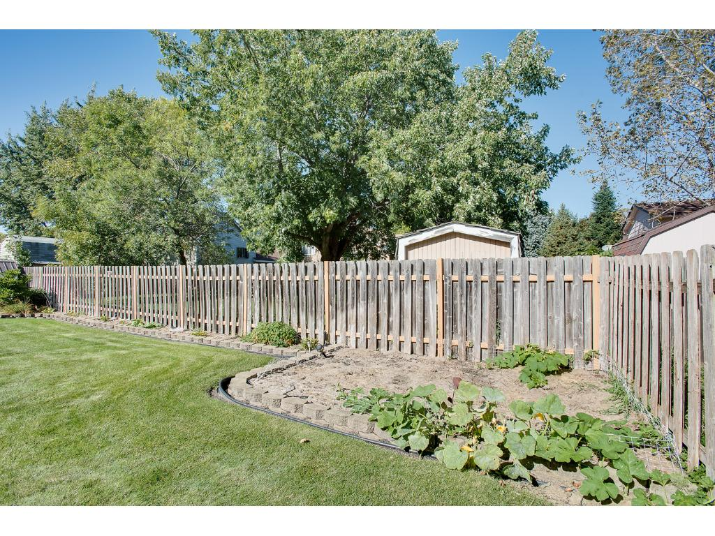 Large fenced in back yard with lots of landscaping