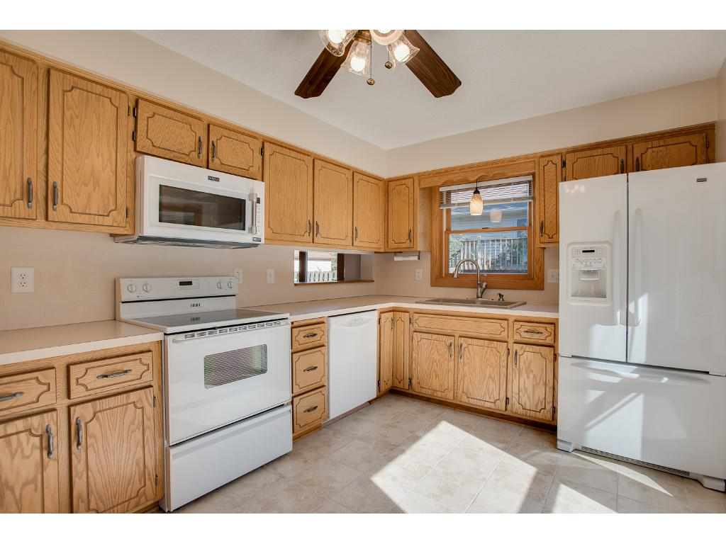 Lots of cabinets in this large kitchen. ceramic tile floors, newer appliances and room for a table.