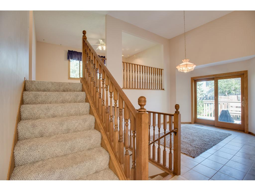 high ceilings and access to the deck from the Dining room