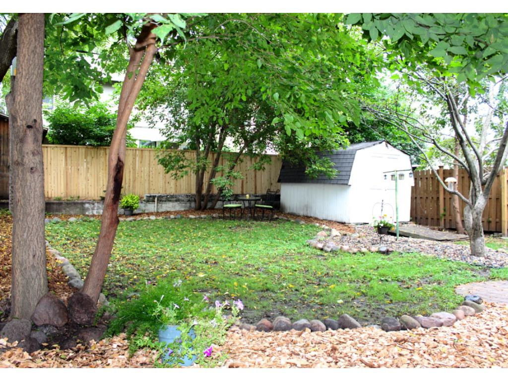 Private backyard with shed and fence.