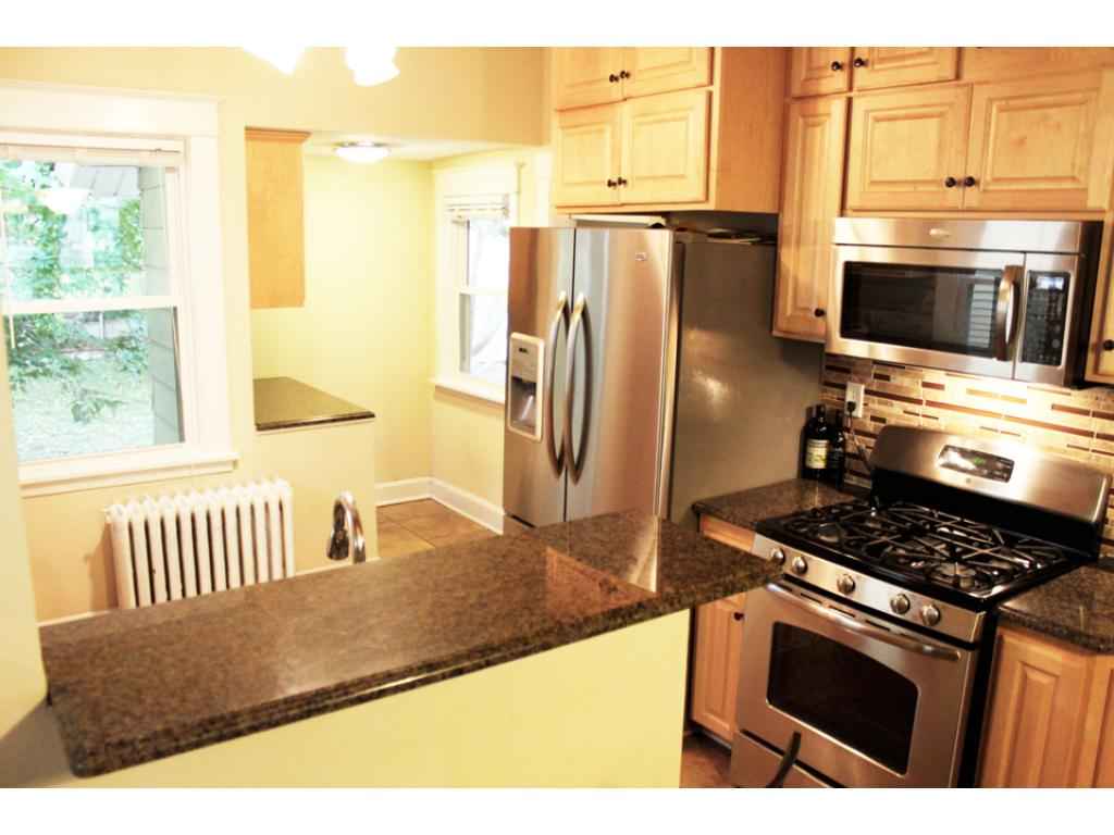 The kitchen has high end stainless appliances.