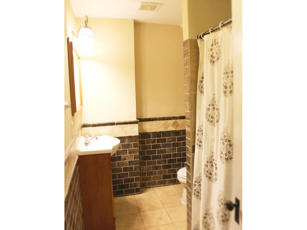 Private master bath with marble tile and heated floors.