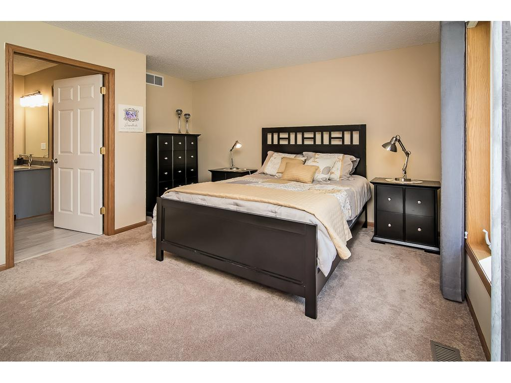 Master bedroom opens to deluxe private bath
