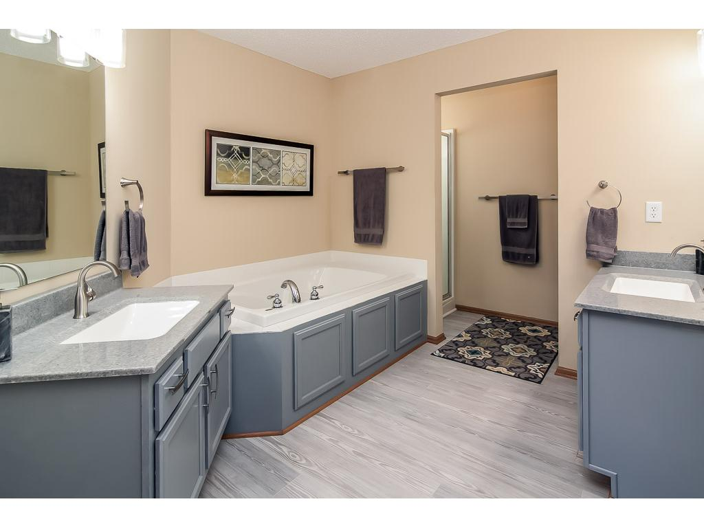 Master bath has double vanities, whirlpool tub and separate shower.