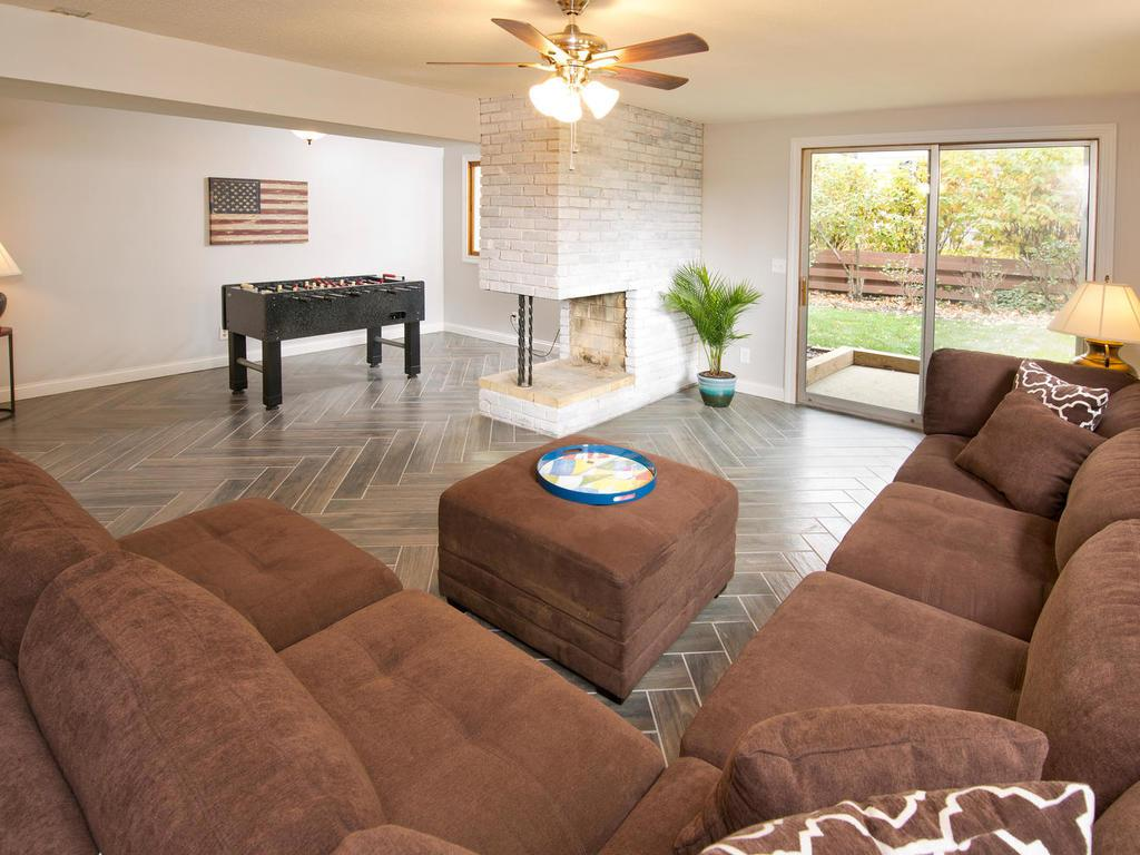 Lower level family room.  Walks out to backyard, and also has a dedicated space for game table or playroom.