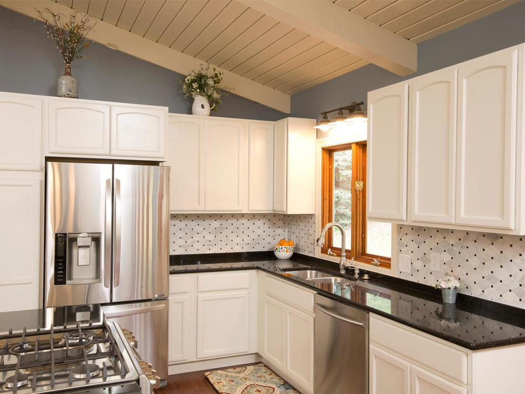 Maple cabinets with soft close hardware, granite counter tops and high end stainless appliances.