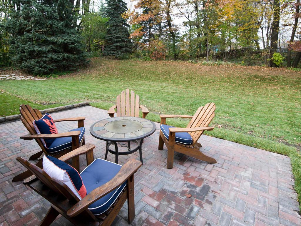 Large new paver patio overlooking large partially fenced private backyard. Access is off the Kitchen.