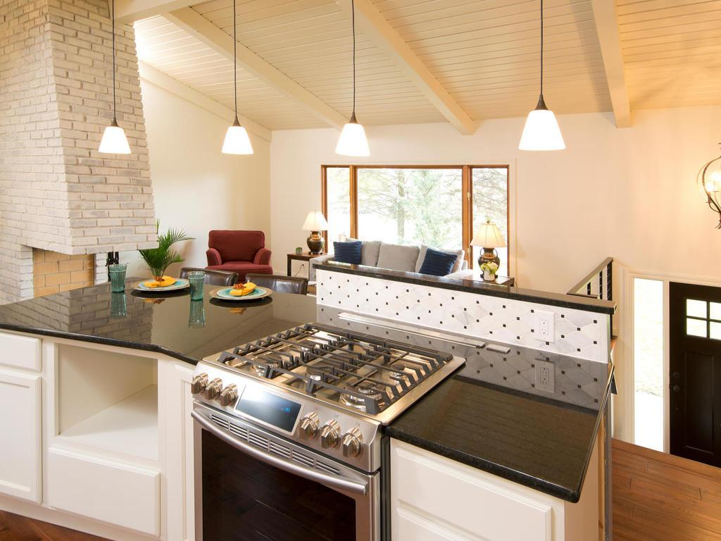 Chefs kitchen with high end appliances, granite countertops, tile backsplash and maple cabinets.