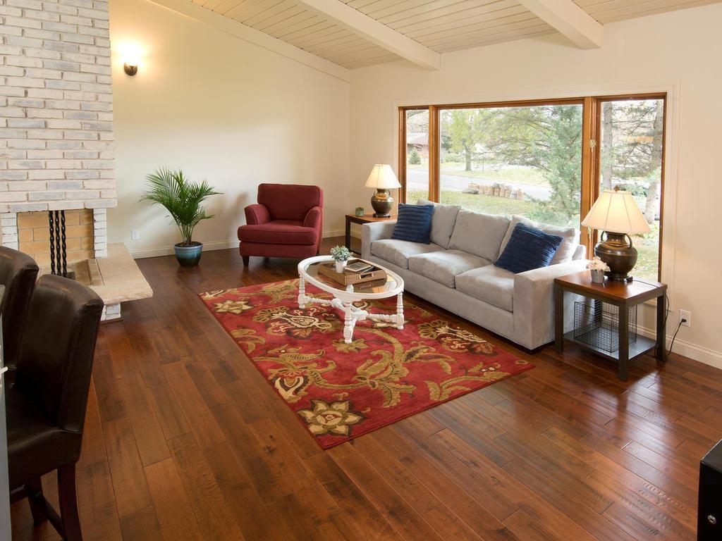 Upper floor living room with hardwood floors and beautiful bright vaulted ceilings.