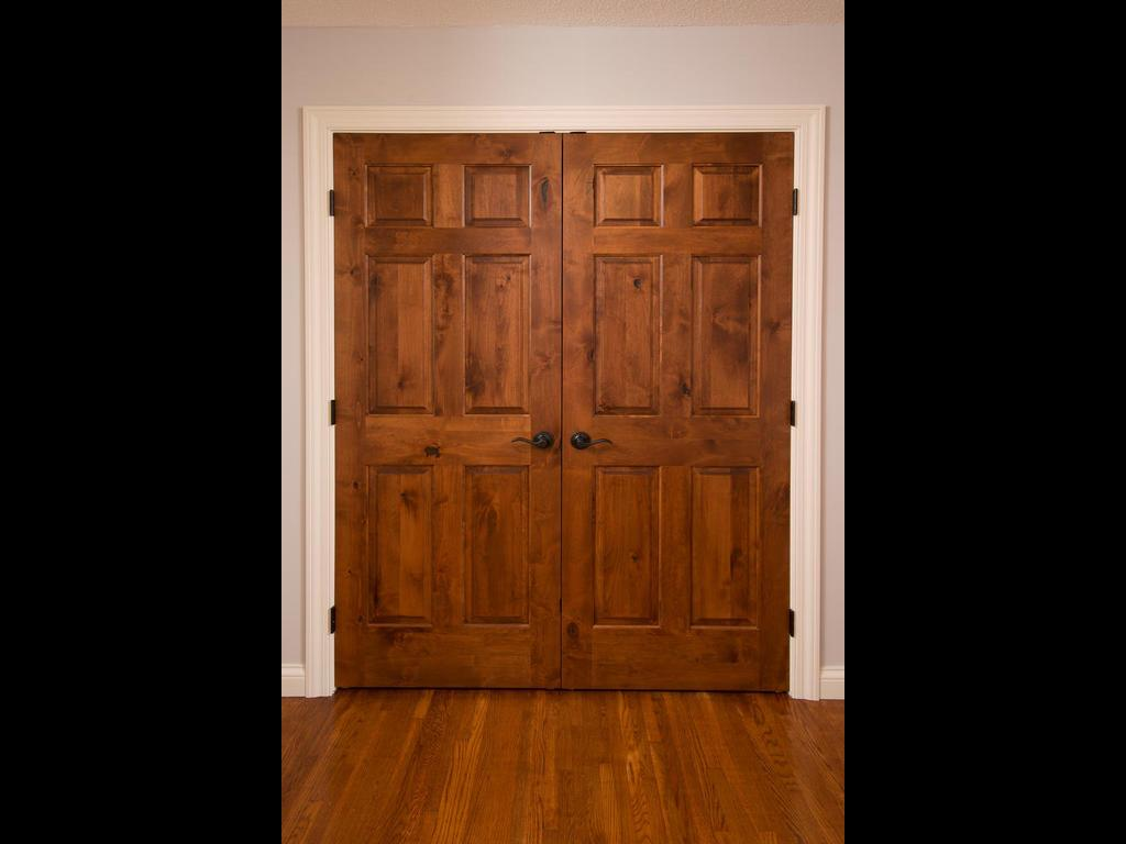 Gorgeous knotty alder doors throughout home.