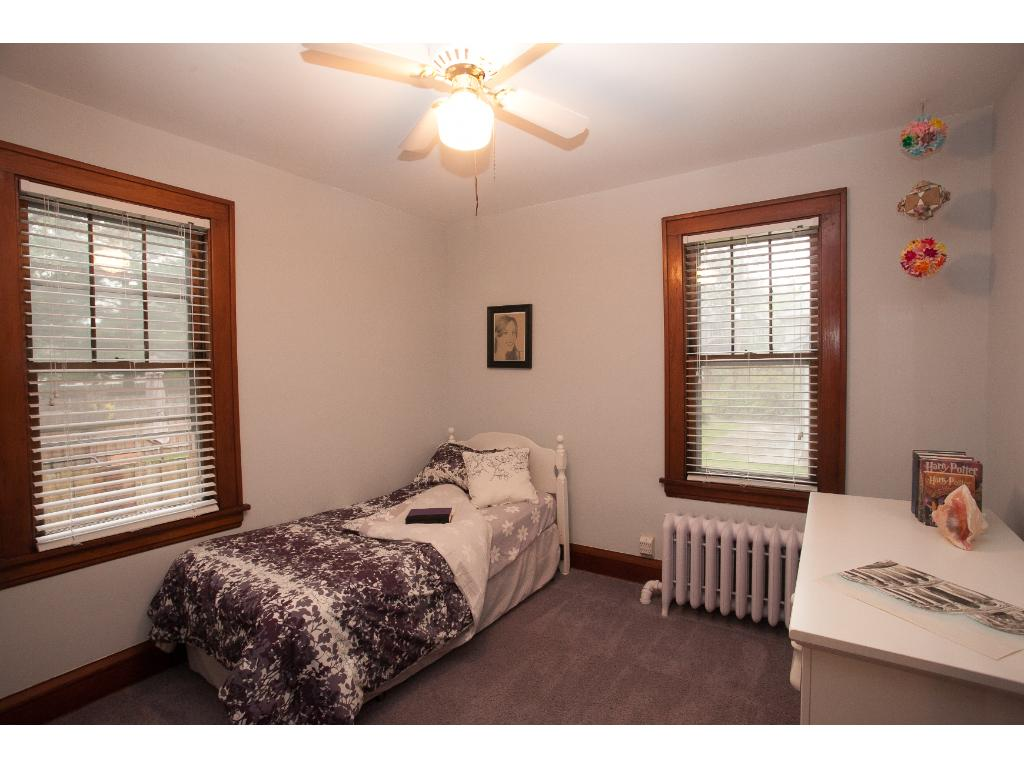 One of two main level bedrooms--yes, hardwood floors are under the carpets.