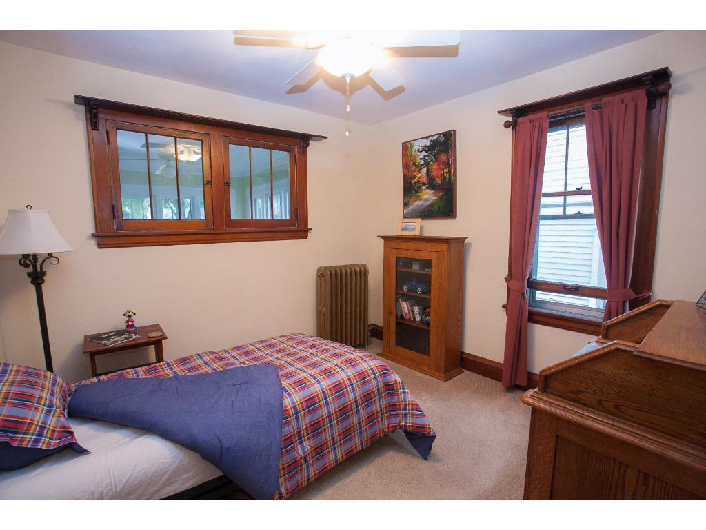 Second main level bedroom--both rooms offer ample closet space.