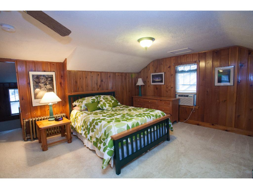 Up the gentle slope of the staircase you'll be impressed with the space of the master suite! Notice the headroom!