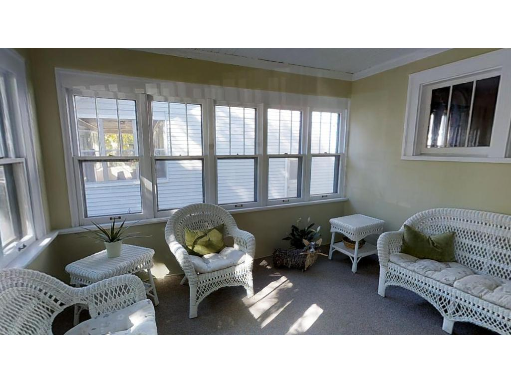 This sunny front porch welcomes you and provides great extended living space many months of the year!