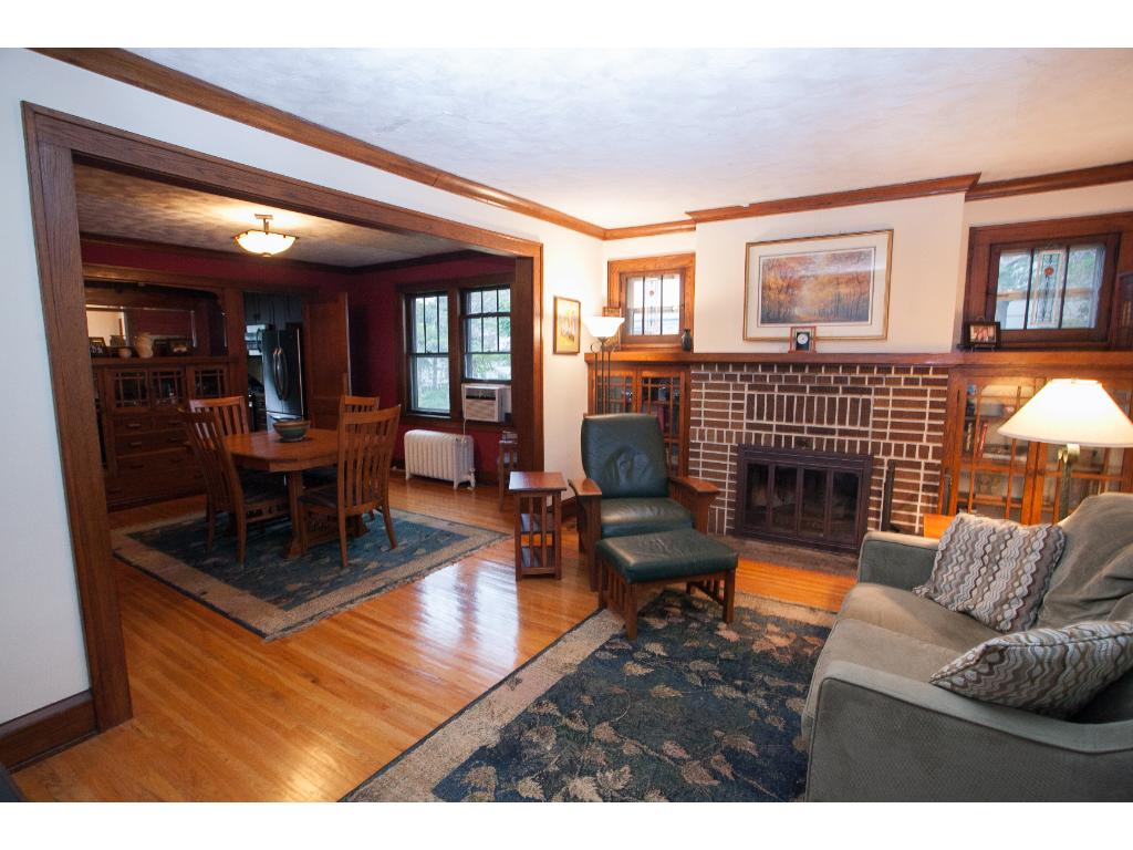 Lots of south-facing light floods the living room. Highlights include a wood burning fireplace and glass-door bookcases.