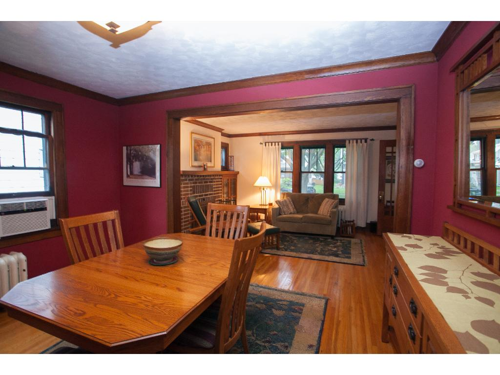 The spacious dining room provides plenty of space for both a large table and a sideboard for serving.