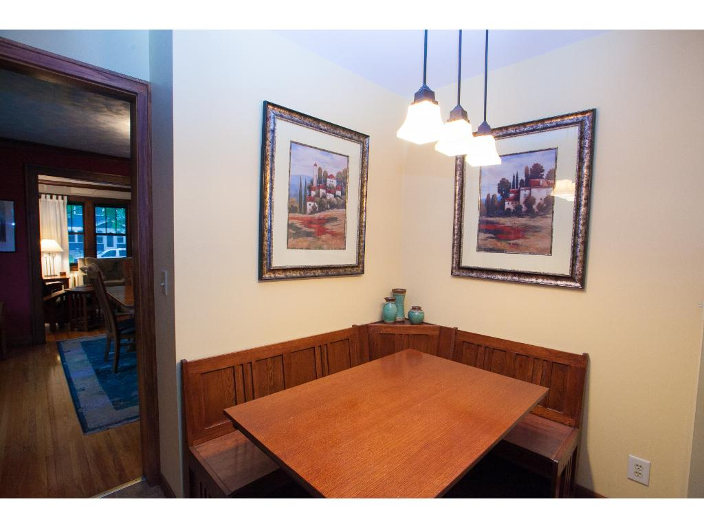 Great dining nook in the kitchen adds functionality and prep space.