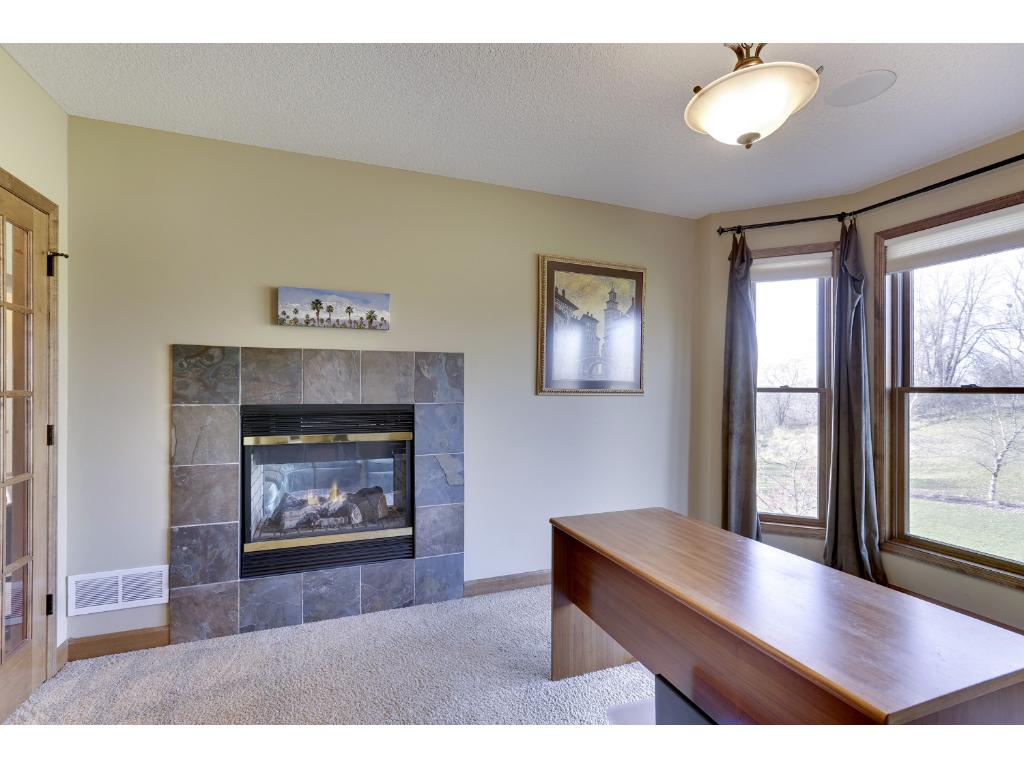 Nestled behind a set of french doors you will find the main floor office. With a cozy, see-thru gas fireplace, you will enjoy curling up with your favorite book and relaxing in this tranquil space.