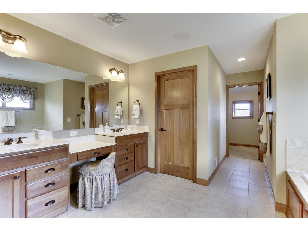 The Master Bath features two elevated sink vanities, a large jacuzzi tub, water closet, a walk-in shower with two shower heads, and a spacious master closet - as relaxing as a trip to the spa.