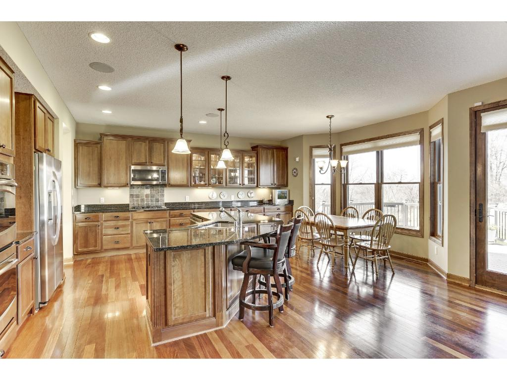 The heart of the home, this gourmet Kitchen is sure to please with granite countertops, a large island with breakfast bar and an informal dining area.