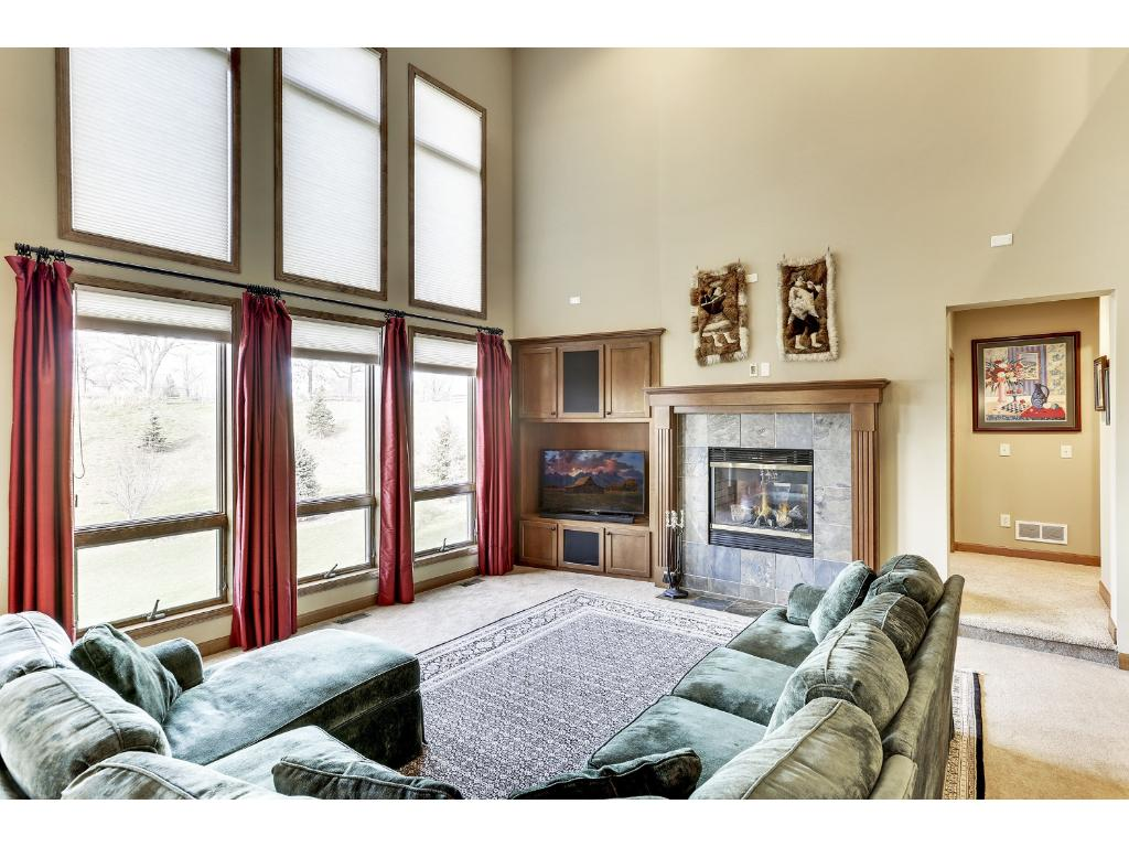 A wall of windows with south-westerly views fill the two-story Great Room with lots of natural sunlight. Curl up in front of the gas fireplace and enjoy movie night!