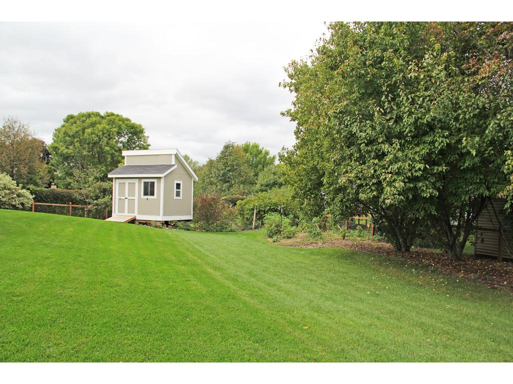 Beautiful backyard with a spacious garden shed - perfect for your lawn mowers, patio furniture, bikes, etc...