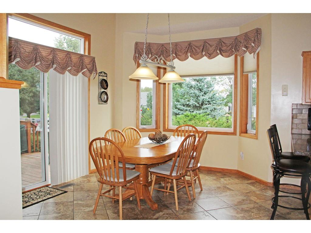 Wonderful dining area with an abundance of natural lighting!  Patio door leads you to the backyard deck and patio area - great for entertaining!