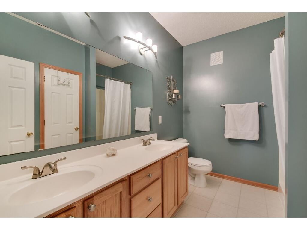 Clean and bright master bath with double vanity.