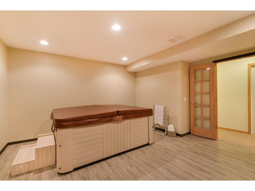 Relaxing spa and workout room with indoor hot tub to enjoy all year round!
