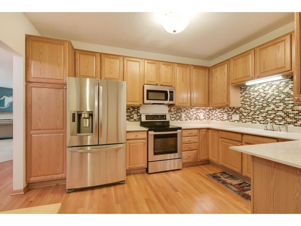 Stainless steel appliances, stunning backsplash, quartz countertops, and ample cabinetry.