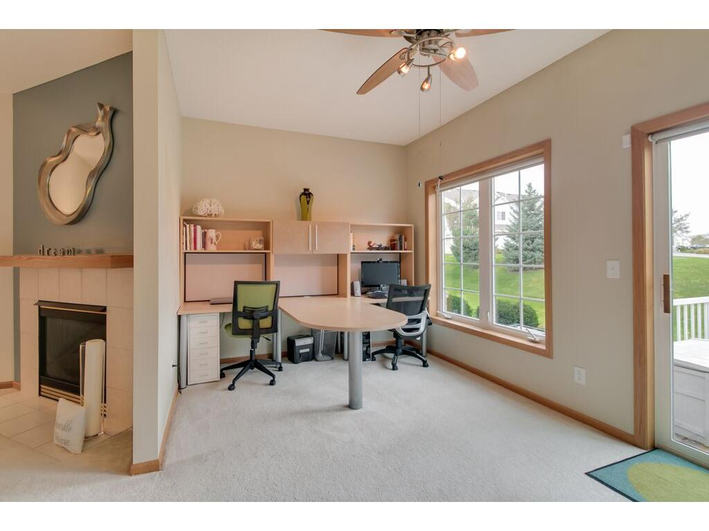 Private office, playroom, or additional living space with large window and access to the great backyard!