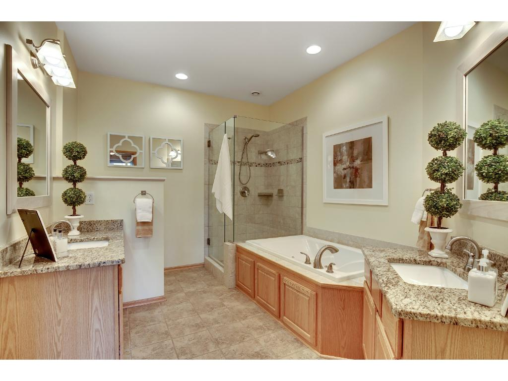 A master bath you can truly enjoy!  Separate sinks for him and her, whirlpool tub and a large walk-in shower.