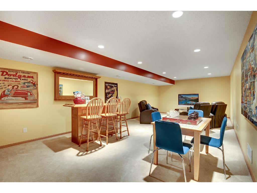 Plenty of room in this large lower level family room to spend time with friends or family.