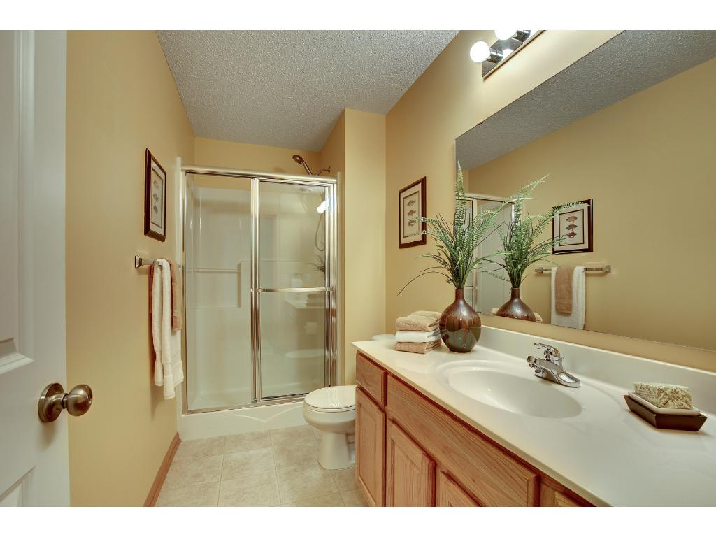 Very nice lower level bath just outside the lower level bedroom.