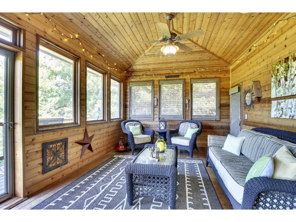 Not the average screened porch! This room is filled w/warm, cedar planks on the walls & ceiling. Unique design allows for extended seasonal use w/no lower breeze from the floor! Walks out to lovely balcony overlooking majestic backyard & wetlands.