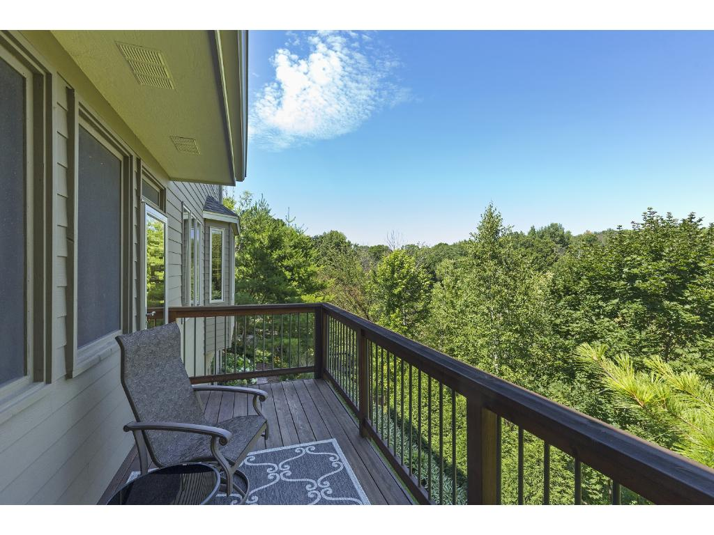 Quaint balcony off the main level screened porch offers the perfect place to relax with a book & enjoy the private setting of this fine home!