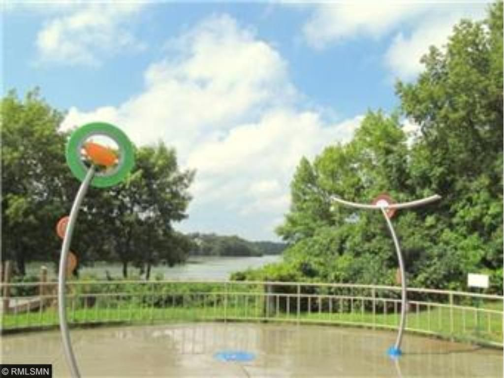 SPLASH PAD OVERLOOKS LAKE & FISHING DOCK