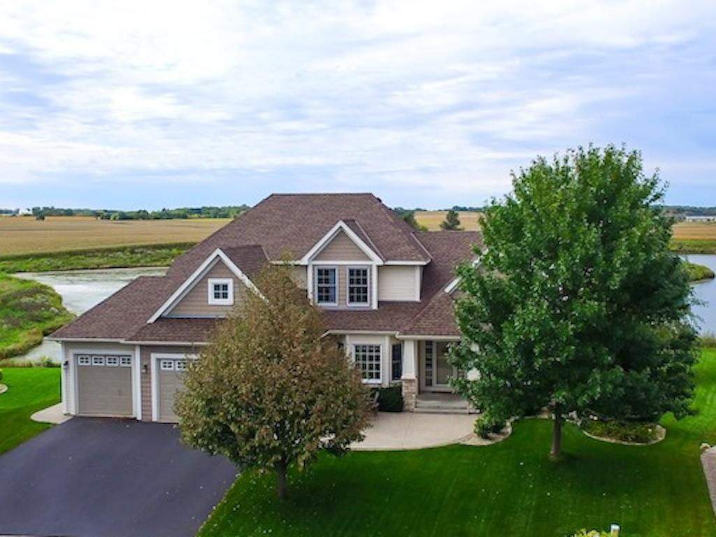Beautifully landscaped, pond and farm in the back.