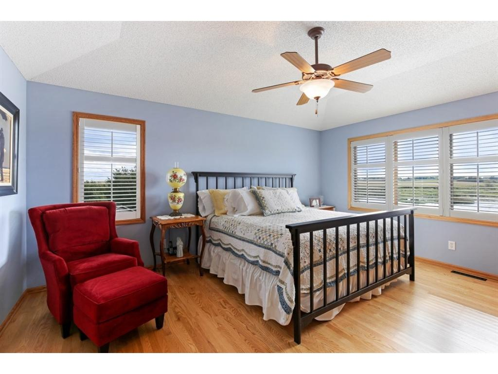 Master bedroom, on upper floor. Those plantation shutters and window overlook the pond.