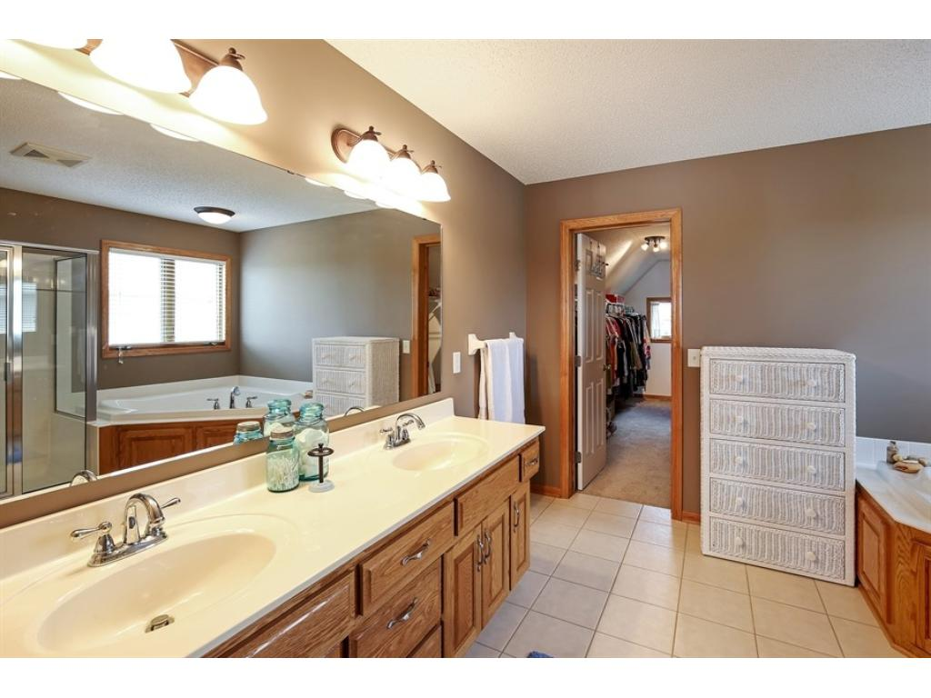 Master bath with dual sinks, soaking tub, separate shower, and a large walk-in closet in the back.