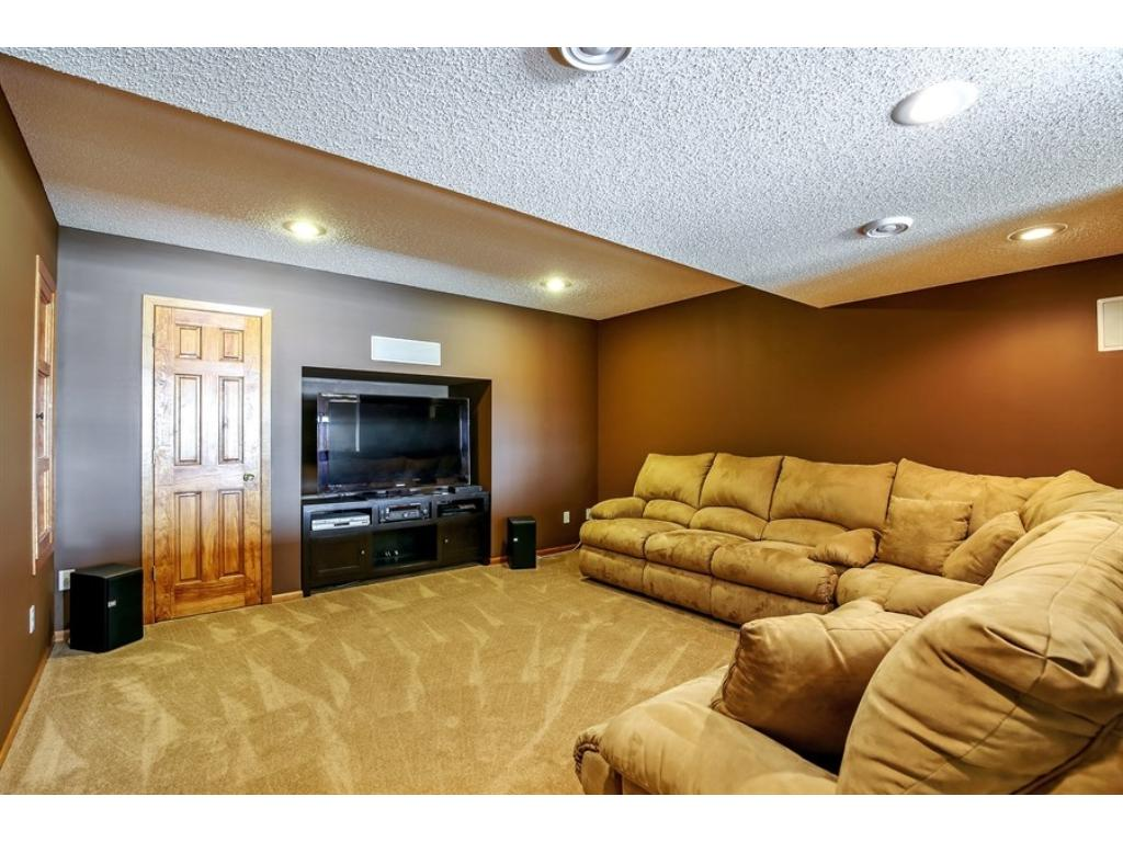The theater room in the lower level has built-in speakers, dimming lights and plenty of room for a popcorn machine!