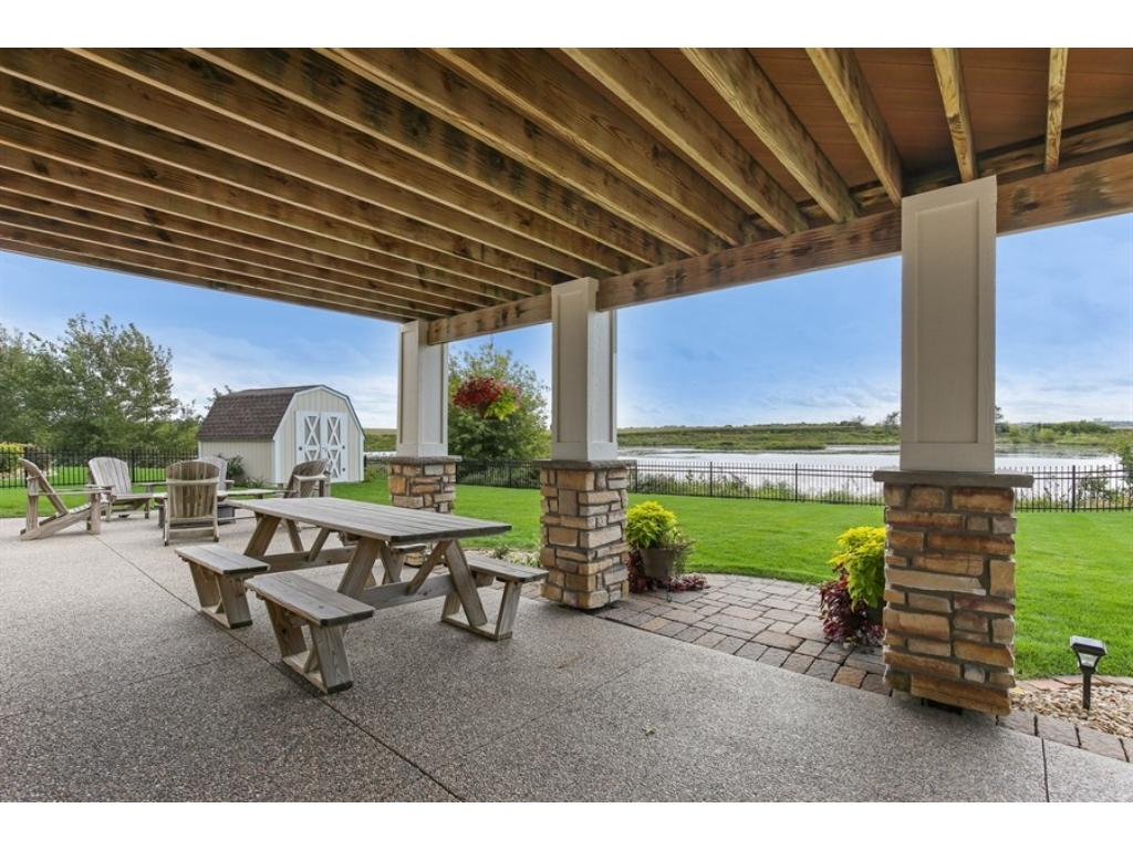 This patio, accessed from the area by the wet bar, has the same exposed aggregate as the front porch area.
