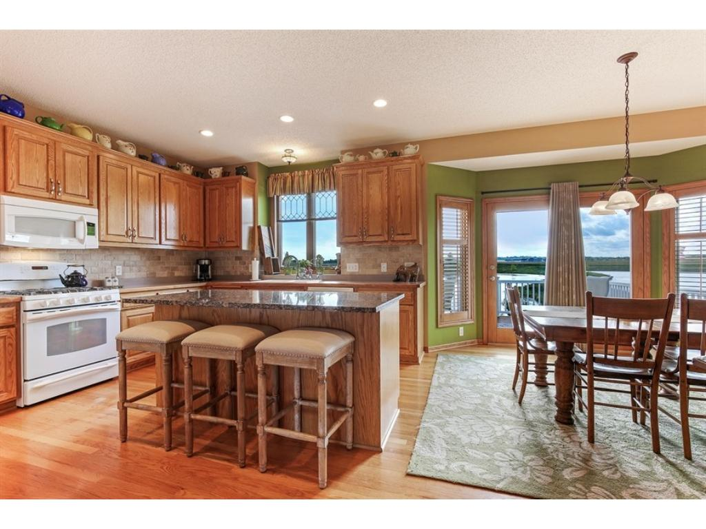 """Spacious, well-appointed kitchen with granite island, 42"""" cabinets - chef's delight!"""
