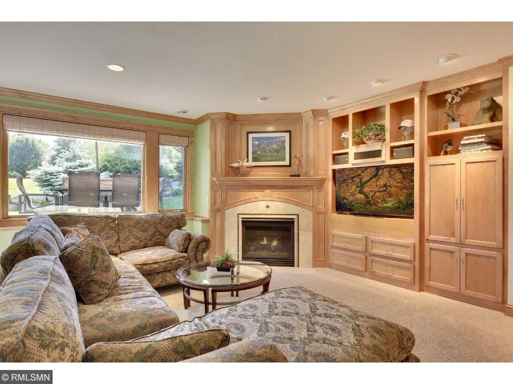 Lower level has a clubhouse feel with spacious sunny openness. Easy access to outdoor patio.