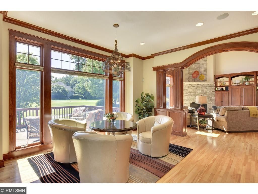 Informal dining room adds extra seating with gorgeous views of the golf course.