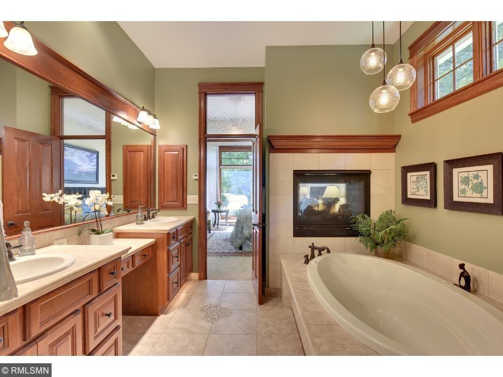 Master en suite features heated tile floors, double vanity, custom lighting, and transom windows.